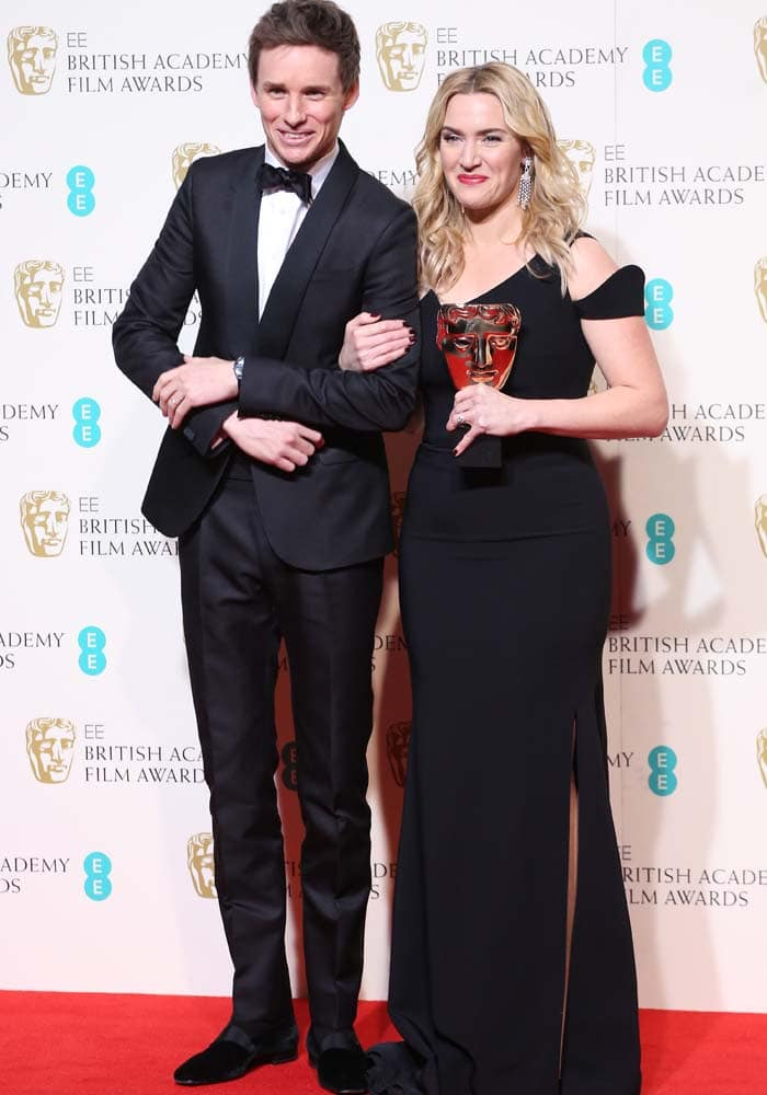 Eddie Redmayne and Kate Winslet pose for photos at the BAFTAs in London