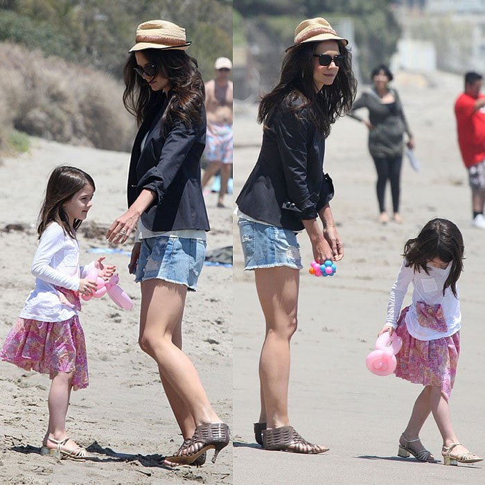 Katie Holmes and daughter Suri Cruise at a Memorial Day beach party in Malibu, California, on May 30, 2011.