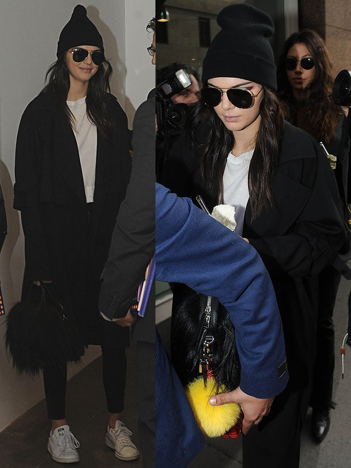 Kendall Jenner wears a beanie over her hair as she leaves the Fendi Fall 2016 fashion show