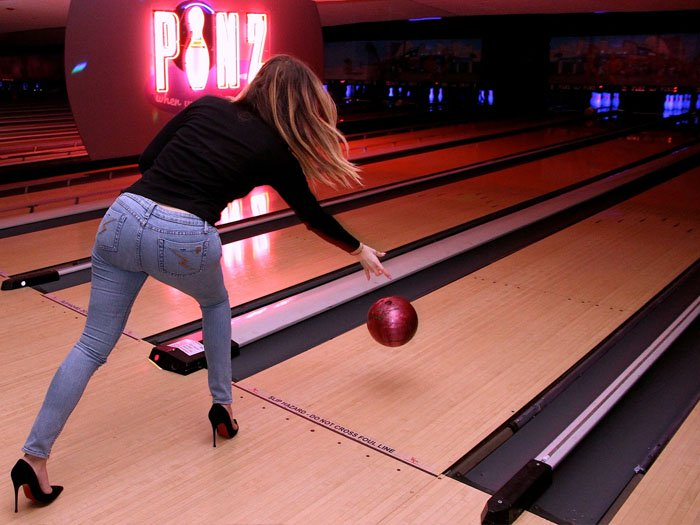 Khloe Kardashian in 5-inch Louboutins at the Robin Hood Project Celebrity Bowling held at Pinz Bowling Alley in Studio City, California, on February 15, 2014.