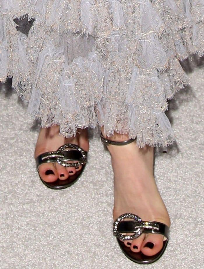 Kiernan Shipka's feet in embellished Jimmy Choo sandals