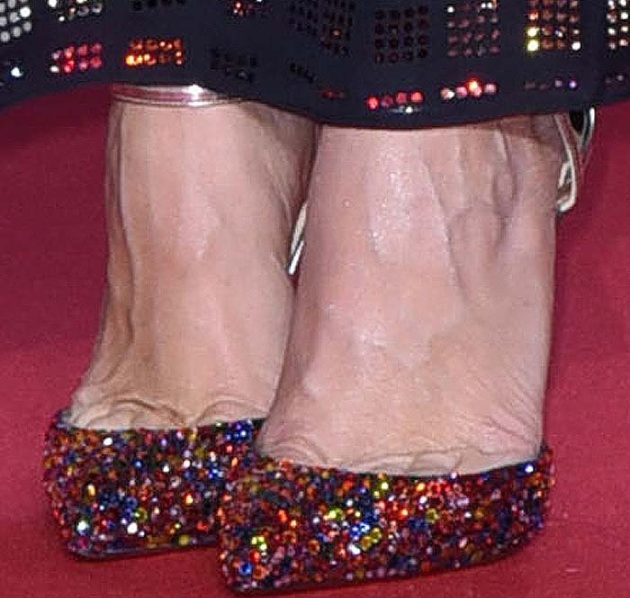 Kristen Wiig's feet in sparkling Christian Louboutin pumps