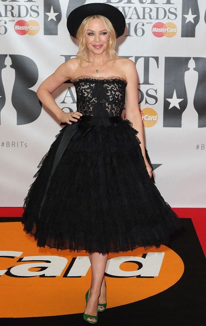 Kylie Minogue In Dolce & Gabbana Dress And Green Pumps