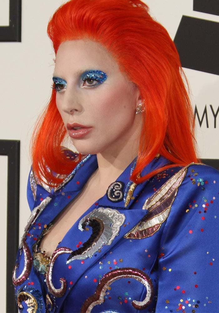 Lady Gaga walked the red carpet in a David Bowie-inspired look at the 2016 Grammys