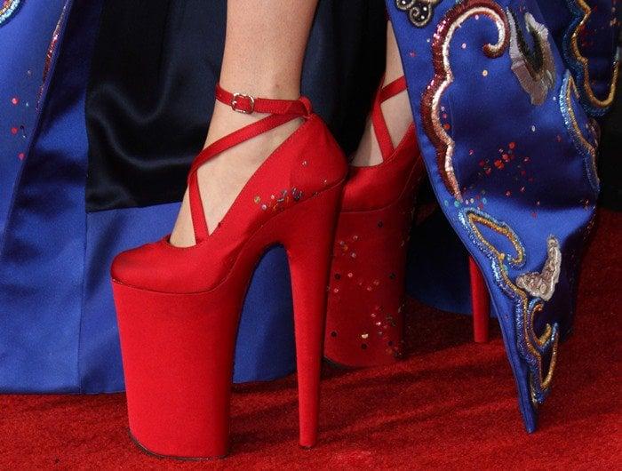 Lady Gaga rocking iconic sky-high red heels