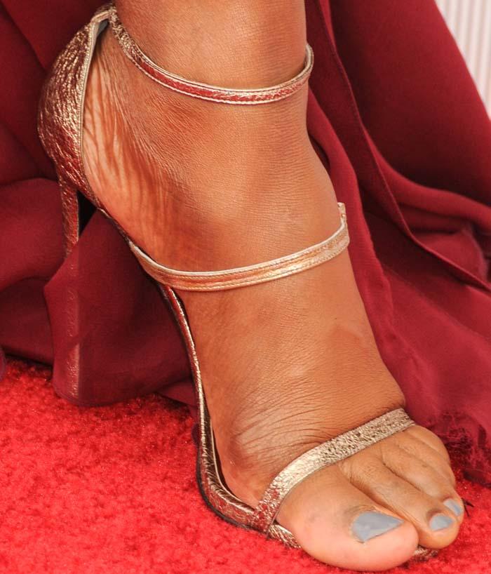 Laverne Cox's feet in metallic Stuart Weitzman sandals