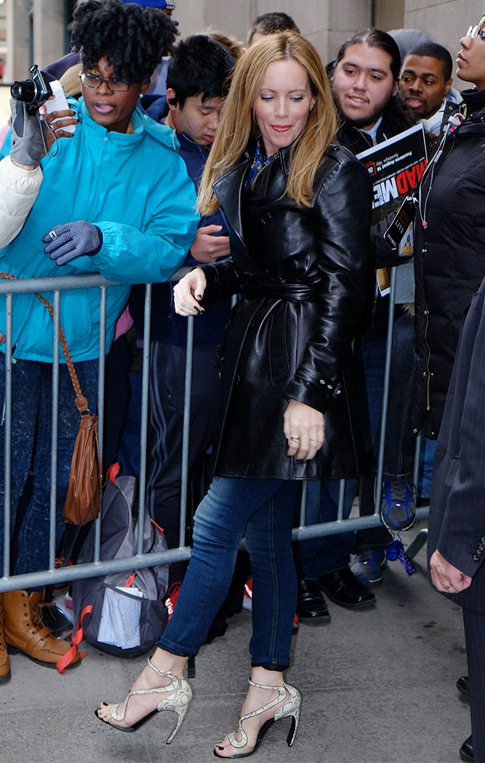 Leslie Mann wears her hair down as she leaves The Huffington Post