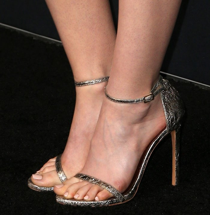 Lily Collins shows off her feet in Stuart Weitzman sandals
