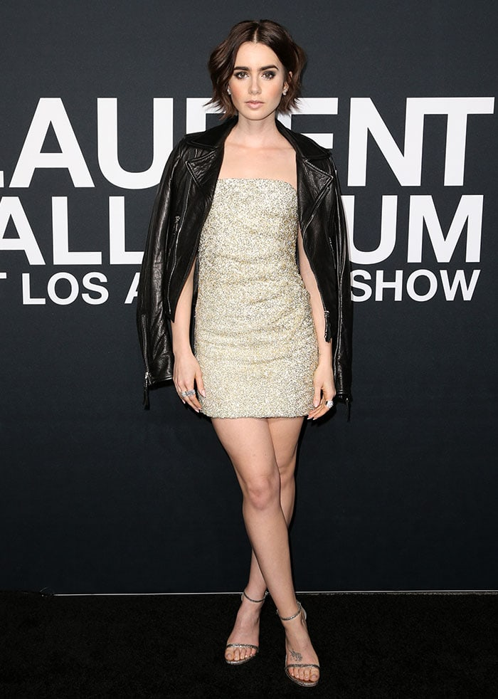 Lily Collins in a shimmering sequined mini dress and a black leather jacket