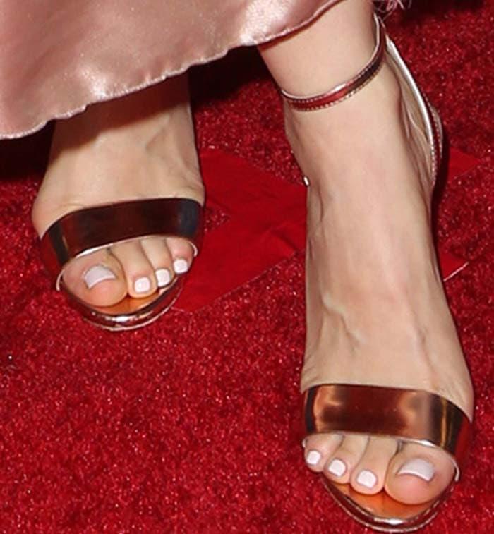 Mena Suvari's feet in rose gold B Brian Atwood sandals