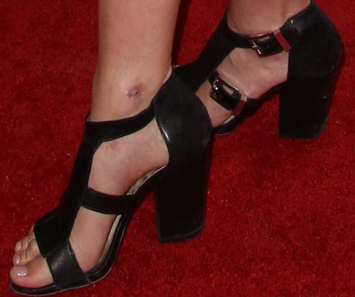 Mischa Barton's feet in black leather cage heels