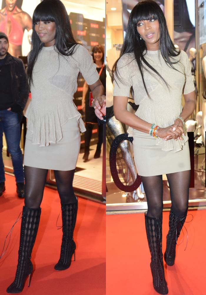 Naomi Campbell wore a neutral-toned peplum mini dress with a pair of knee-high embroidered lace-up boots by Alaïa