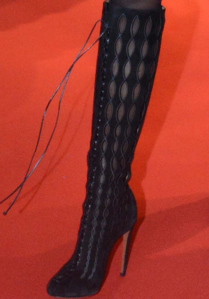 Naomi Campbell wearing knee-high embroidered lace-up boots by Alaïa