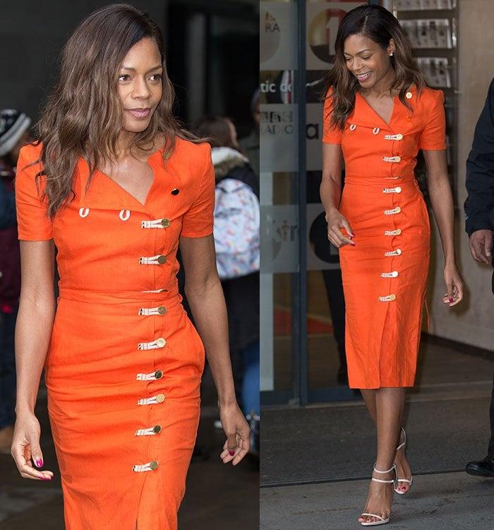 Naomie Harris flaunts the rope-and-button embellishments on her orange Altuzarra dress