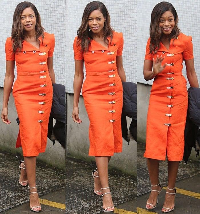 Naomie Harris flaunts her legs in an orange Altuzarra dress