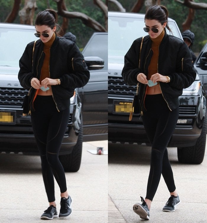 Kendall Jenner wearing Nike shoes while shopping in Beverly Hills on December 22, 2015