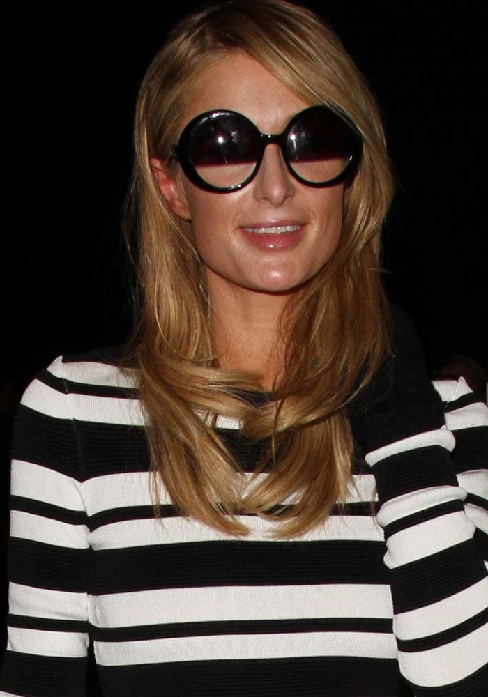 Paris Hilton wears her hair down as she arrives at Los Angeles International Airport