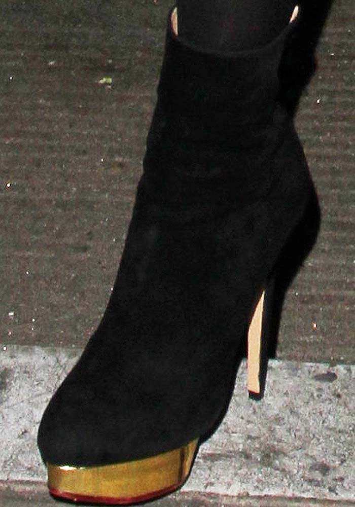 Paris Hilton's feet in Charlotte Olympia suede Lucinda boots