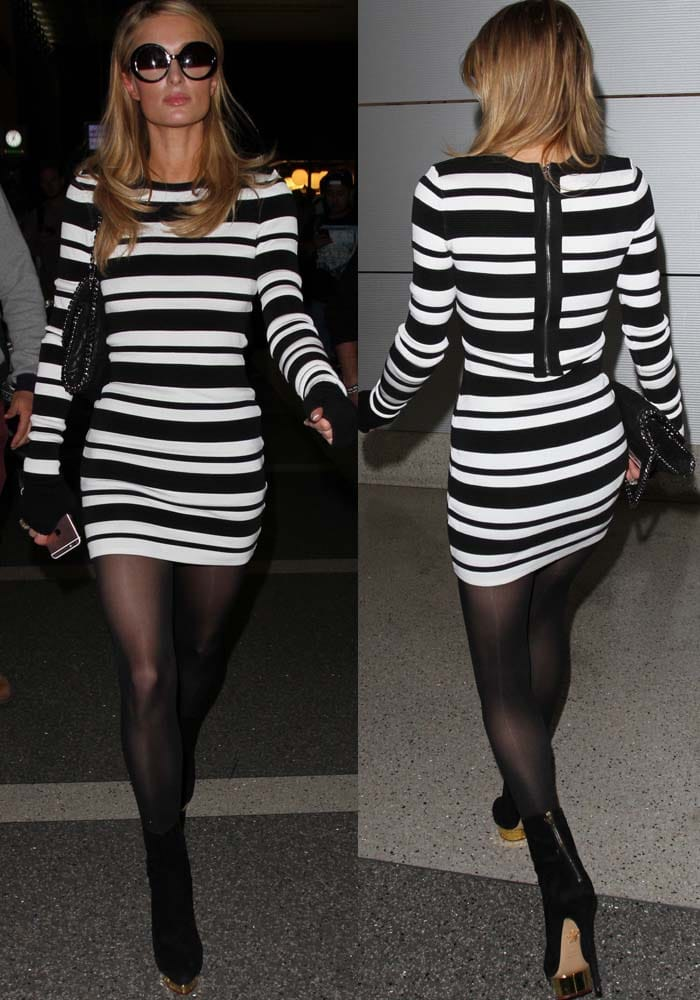 Paris Hilton wears a black-and-white striped bodycon dress as she arrives at LAX