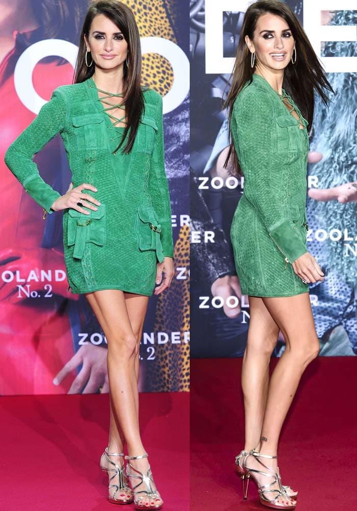 Penelope Cruz wears a short green Balmain dress on the red carpet