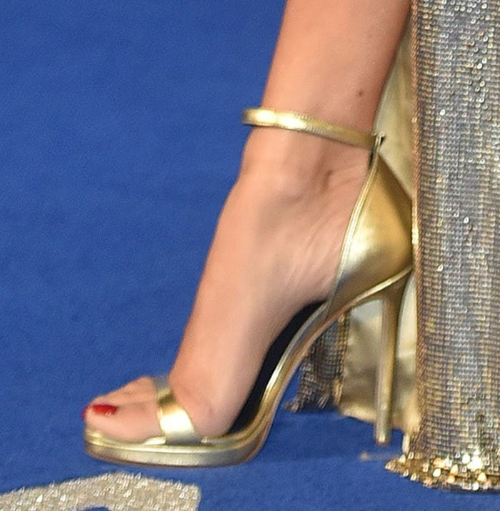 Penelope Cruz's feet in gold ankle strap sandals