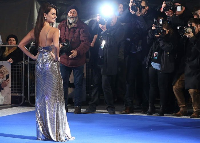 Penelope Cruz stuns on the blue carpet in a metallic gown from Atelier Versace