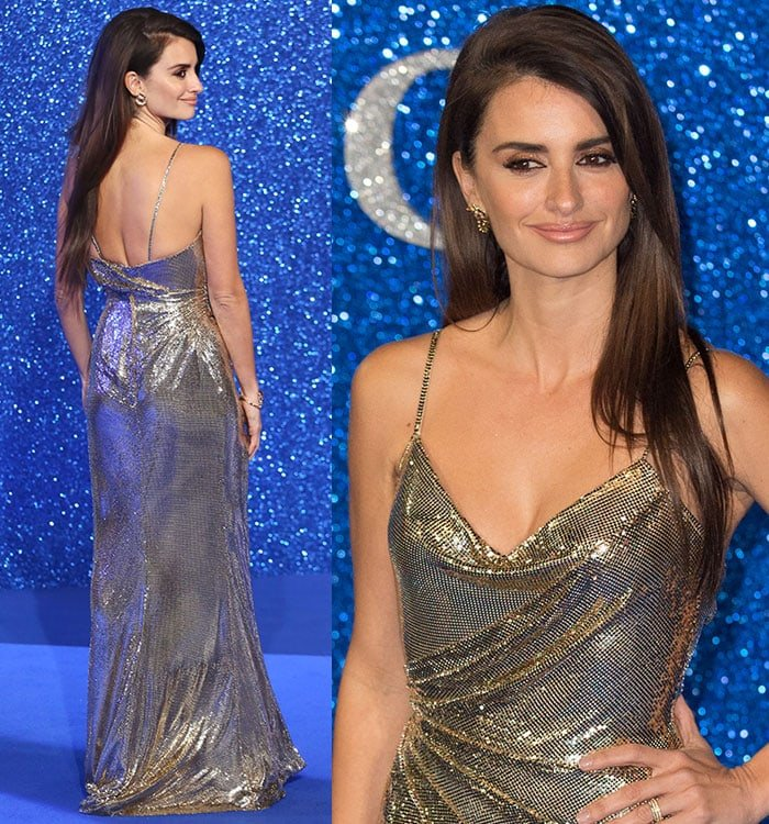 Penelope Cruz wears her brown hair down and flaunts a smoky eye on the blue carpet