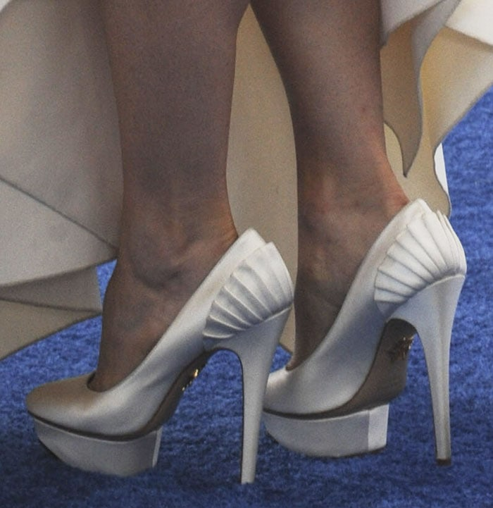 Rachel McAdams shows off her feet in white satin in Charlotte Olympia Paloma pumps