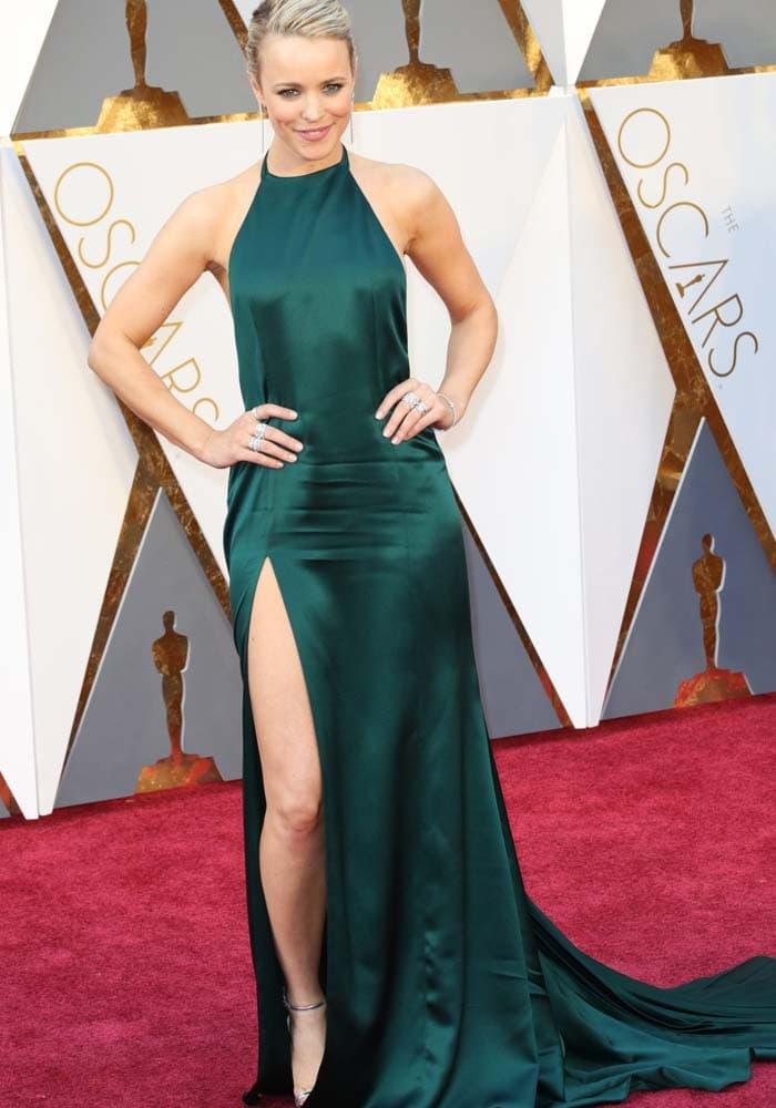 Rachel McAdams wears an emerald green silk dress on the red carpet