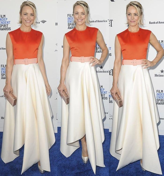 Rachel McAdams worea vibrant orange sleeveless top half with a cutout back