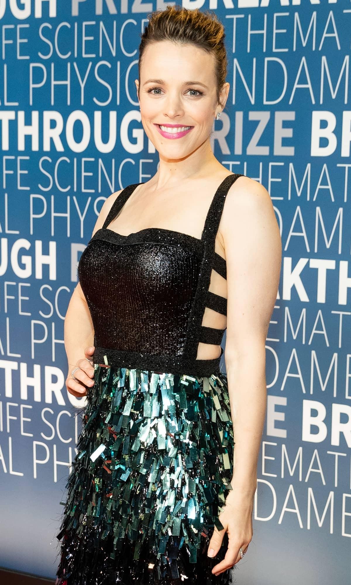 Rachel McAdams looks stunning in a Rami Kadi Couture dress with metallic sequin appliqués and Hearts On Fire jewelry