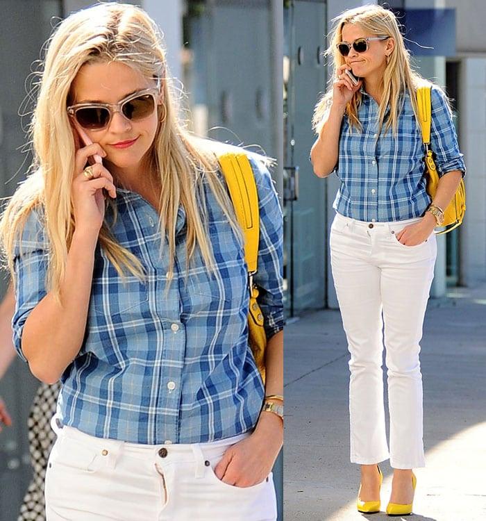 Reese Witherspoon accessorizes with a yellow Elizabeth and James bag