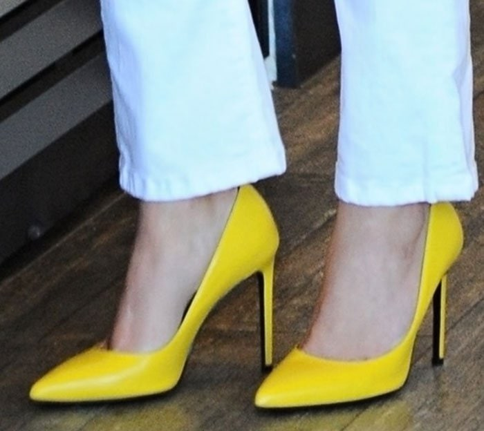 Reese Witherspoon's feet in bright yellow Saint Laurent heels