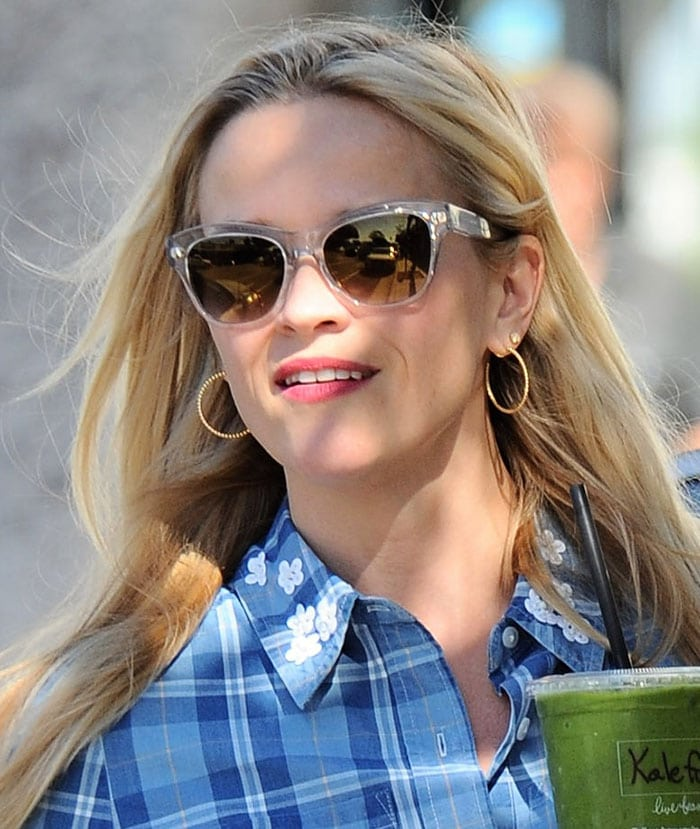 Reese Witherspoon wears her blonde hair down as she runs errands in Santa Monica
