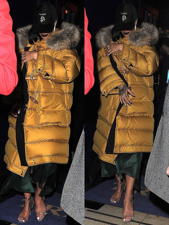 Rihanna covered up her forest-green satin dress and Brian Atwood slingback sandals ensemble with a yellow Burberry fox-fur-trim down-filled duffle coat and a black Tramp nightclub cap on her head