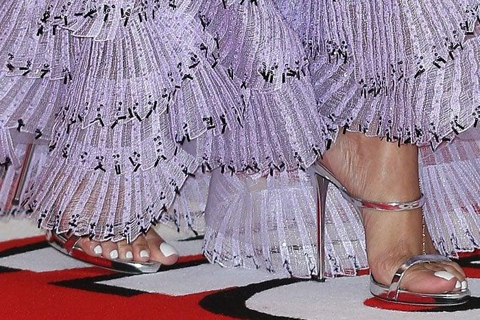 Rihanna shows off her sexy feet in silver Giuseppe Zanotti sandals