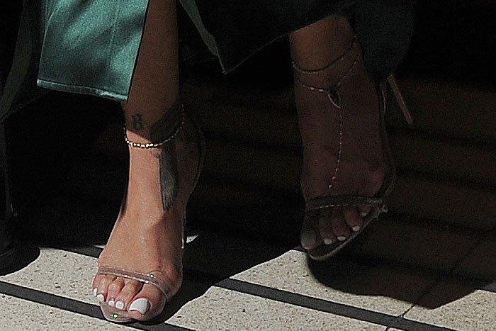 Rihanna gold ankle strap sandals