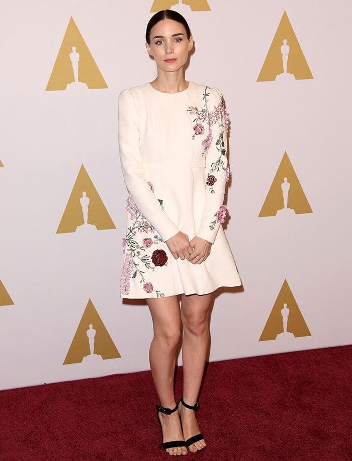 Rooney Mara wears a Giambattista Valli mini dress on the red carpet of the Oscars Nominees Luncheon
