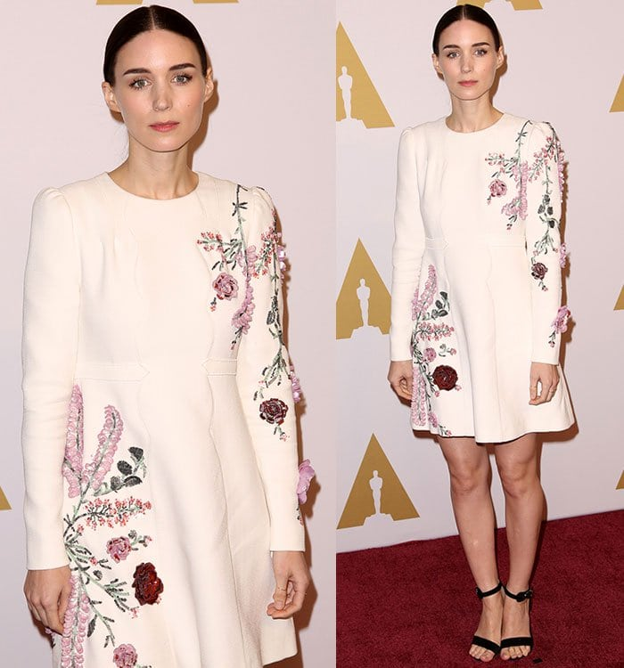 Rooney Mara wears a long-sleeved embroidered Giambattista Valli dress on the red carpet with a pair of black ankle strap sandals