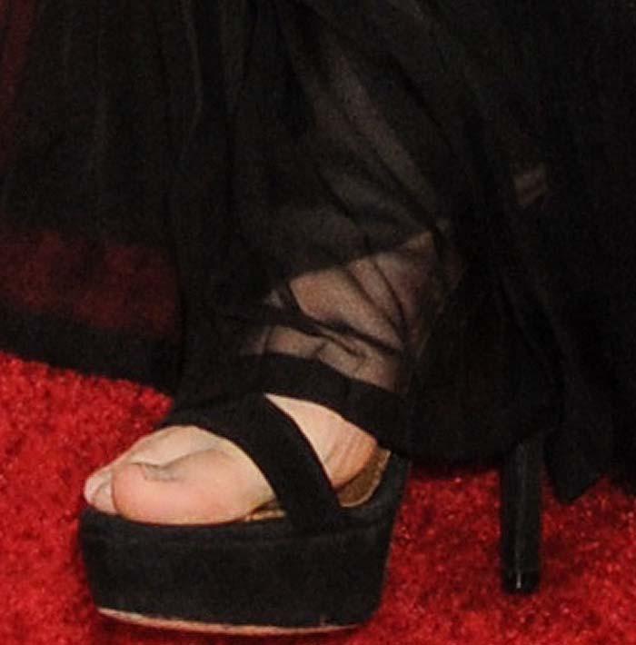 Rooney Mara's feet in black platform Givenchy sandals