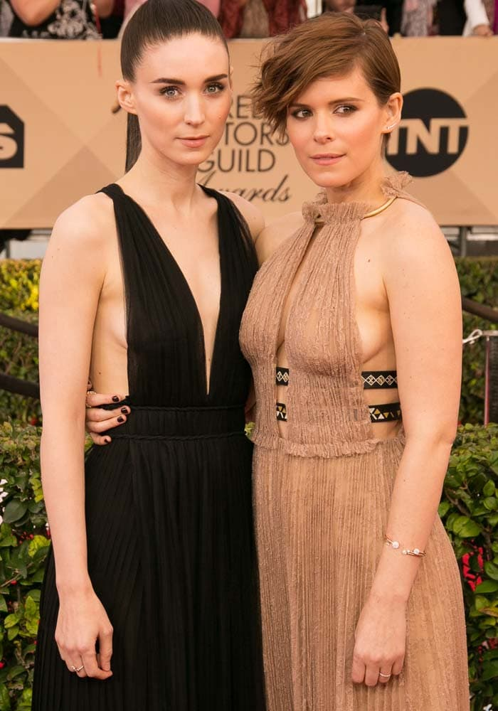 Rooney Mara and Kate Mara pose on the red carpet in Valentino dresses
