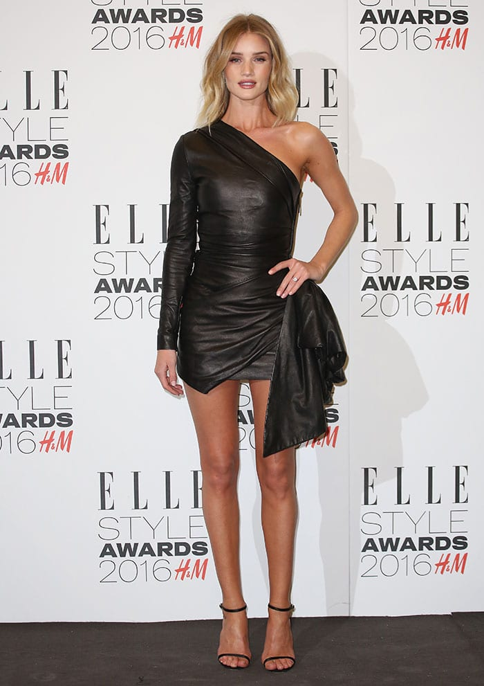 Rosie Huntington-Whiteley shows off her legs in a black leather Roberto Cavalli dress