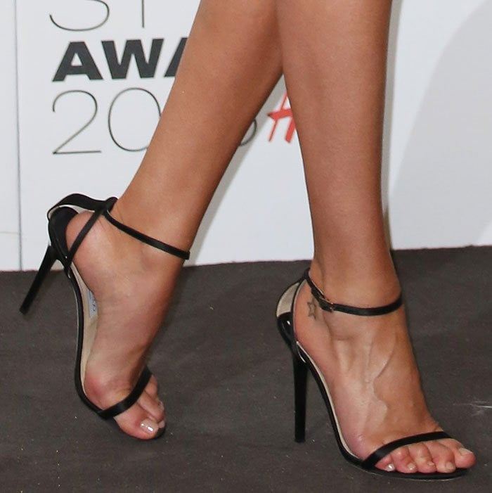 """Rosie Huntington-Whiteley's feet and foot tattoo in strappy """"Minny"""" sandals"""
