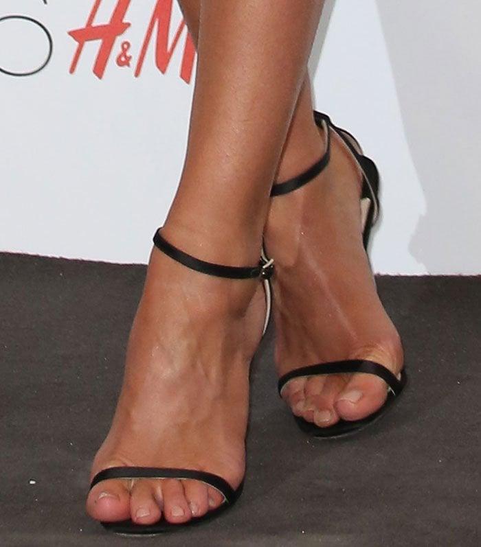Rosie Huntington-Whiteley's feet in strappy Jimmy Choo sandals