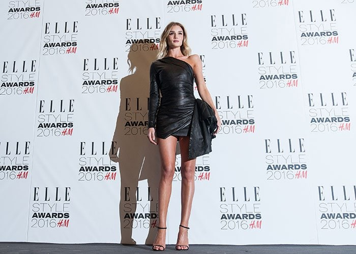 Rosie Huntington-Whiteley shows off her model figure in a black leather minidress at the 2016 Elle Style Awards