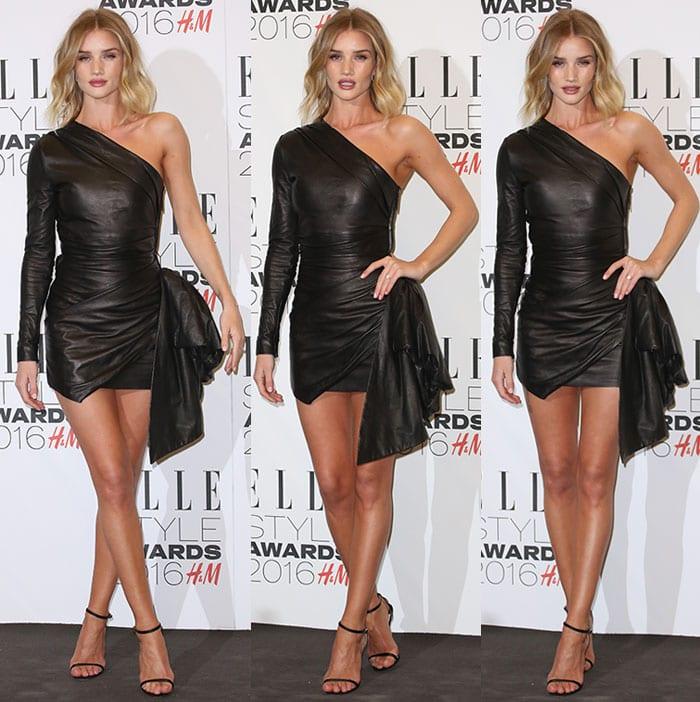 Rosie Huntington-Whiteley wears a Roberto Cavalli leather dress