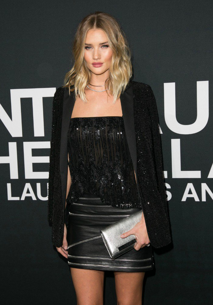 Rosie Huntington-Whiteley wears a zipper-embellished leather Saint Laurent mini skirt at the Saint Laurent fashion show in Los Angeles