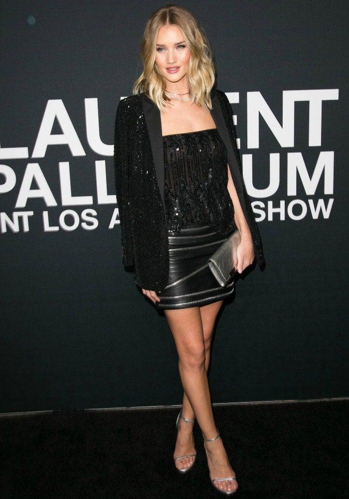 Rosie Huntington-Whiteley wears a sparkling black-and-silver ensemble on the black carpet