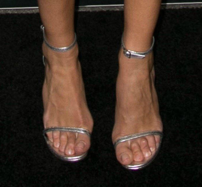 Rosie Huntington-Whiteley's feet in strappy silver Stuart Weitzman sandals