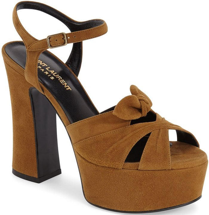 Retro-chic leather sandal fashioned with a slim ankle strap and a graceful bow embellishment